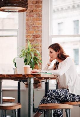 Woman working on website